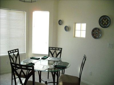 Kitchen dining area with picture window that features Elephant Rock.