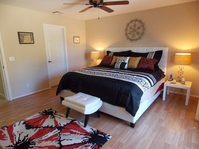 Palm Springs house rental - Master bedroom with door to pool and walk in closet, en suite bath.