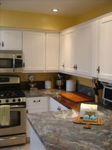 Chefs kitchen complete with all high end appliances, kitchen aid, cookware....