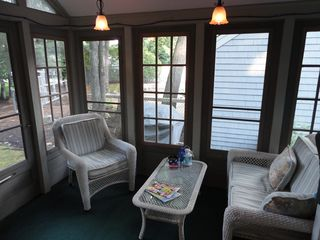 Laconia townhome photo - Screened Porch overlooking pool area