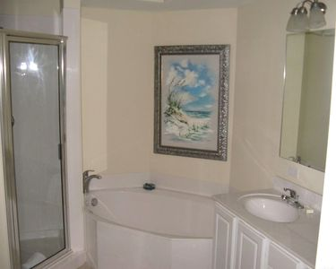 Huge Mstr. Bathroom with 2 sinks and walk-in shower. Relax after a day of sun.