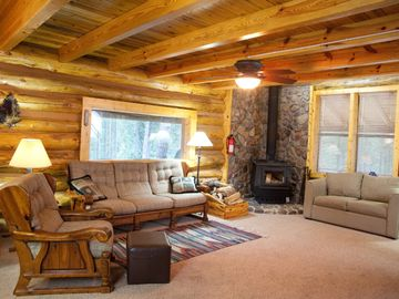 'Great room, rock wall, wood burning furnace
