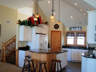 Corolla house photo - Kitchen w/ granite, 2 sinks, breakfast bar, pantry & stairs to loft. Sound Views