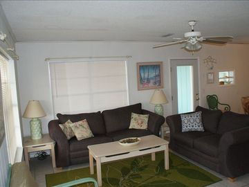 open living room with a flat screen tv- great for watching games