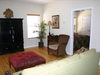 Looking from Living Room into Master Bedroom w/ King bed, TV, Private Bathroom