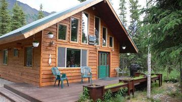 Cooper Landing house rental - Kenai River Mystic Lodge front deck with BBQ ready for your catch of the day