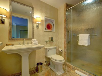 Full guest bathroom with shower in living room.