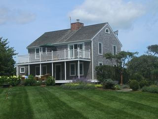 Madequecham house photo - New England Saltbox with manicured lawn and gardens.
