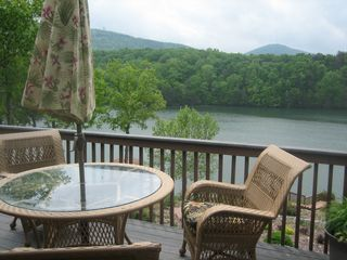 Huddleston cabin photo - Outside dining from an oversized deck and new wicker furniture