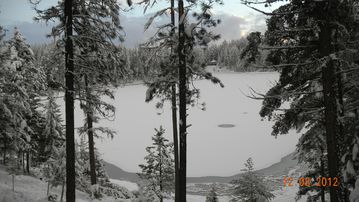 Winter picture. Looking down from deck onto the frozen lake.