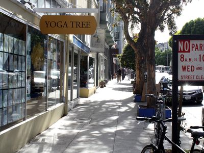 Shops and cafes along Hayes Street including a yoga studio