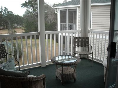Enclosed deck overlooking pool