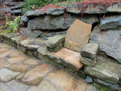 Details: Custom stone chair built by local stone craftsman over looking waterfal
