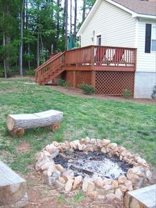 Back deck off the king w/ table, chairs, chaise lounges, gas grill & fire pit.