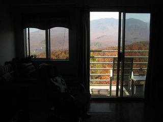 photo taken in peak fall season, from den, looking out the window and balcony. - Gatlinburg condo vacation rental photo