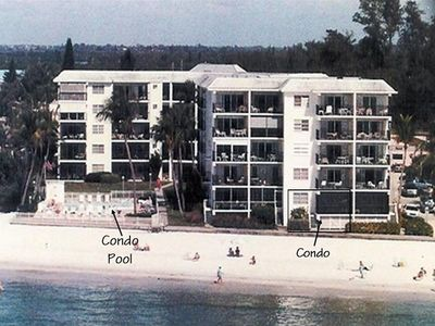 View of Estero Beach Club condo, pool and beach
