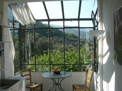 Country house in an olive grove with a large garden and a panoramic view
