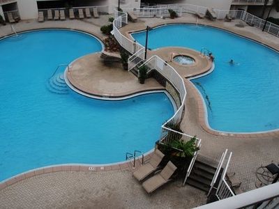 View of beautiful swimming pools and hot tub from our balcony.