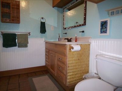This charming bathroom is big enough it has it's own ceiling fan.