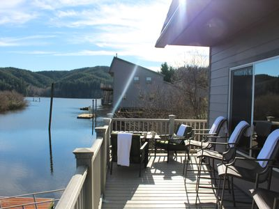 Balcony with BBQ, Fire Pit, and Dock with views of Tenmile Lake.