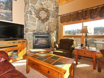 Flat screen TV and gas fireplace in the living area