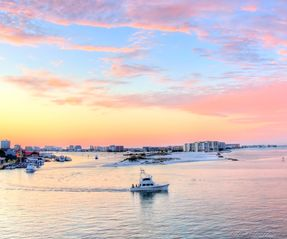 Our condo is the closest one. The fishing fleet passes your balcony. - Destin condo vacation rental photo