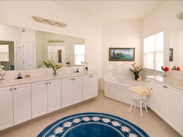 Spacious triple sink spa master bathroom with garden tub and walk-in shower