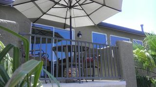 Henderson house photo - Umbrella Covered Balcony w/Sitting Area & City View!