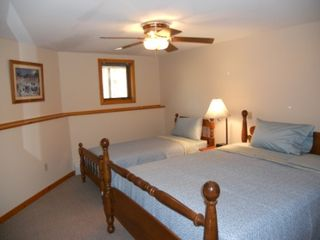 North Conway townhome photo - Queen and Twin beds in Basement bedroom. Full closet and shelves for storage.