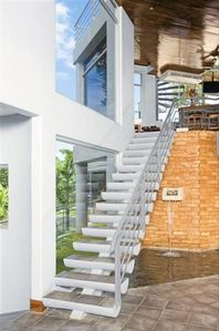 Staircase leading to the 2nd Floor living Room and Kitchen.  Water fountain