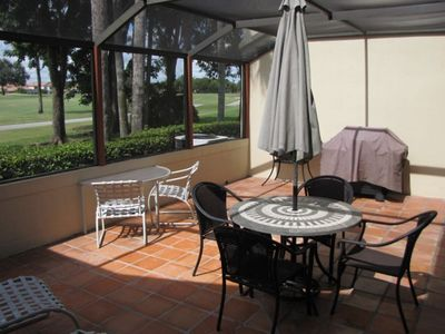 double fairway golf view from screened in porch and bbq grill