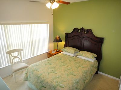Queen bedroom with new bedding, deluxe pillow-top mattress, and new furniture.