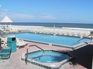 Daytona Beach Shores condo photo - Sparkling ocean side heated pool, hot tub, & sun deck