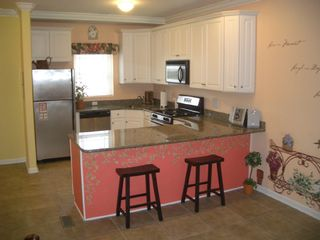 Granite Counter Tops & Stainless Steel Appliances - Wildwood townhome vacation rental photo