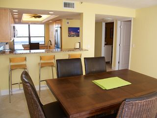 Redington Shores condo photo - Dining room and bar overlooking kitchen.
