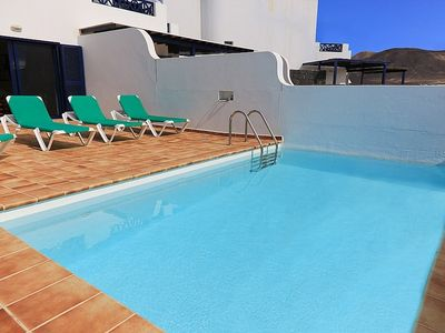 Private heated pool with plenty of sunbeds