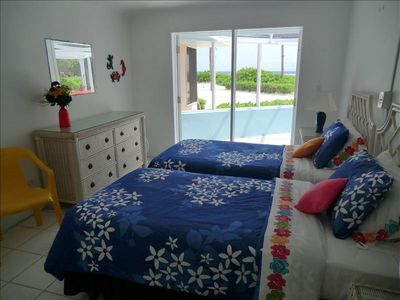 Twin bedroom opens to the porch and the sea