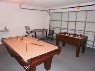 Emerald Island house photo - Games room with pool table and foosball table