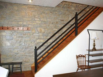 Exposed stone wall behind stairway