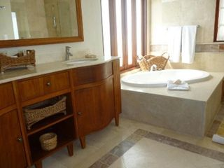 Punta Cana condo photo - Bathroom suite with bath tub, separate full shower/toilet/his and her's sink