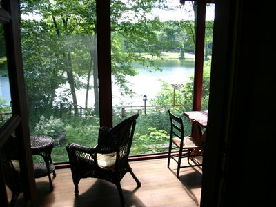 View of porch and lake from inside the cottage
