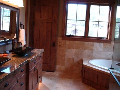 View of typical master bathroom w/ Jacuzzi tub.