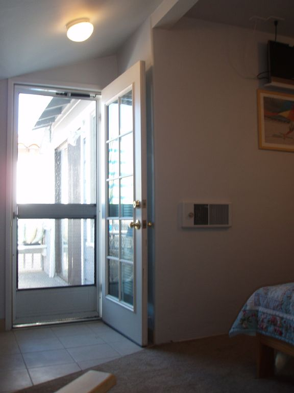 Screen bedroom door for sea breezes and view