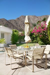 Al Fresco dining poolside while enjoying dramatic mountain views