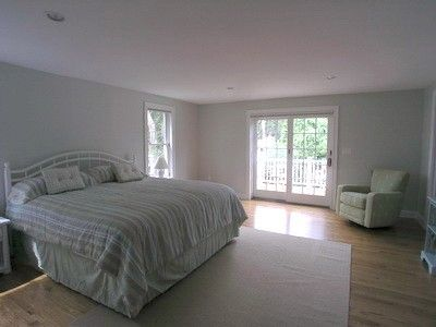 Master bedroom 1st floor, king size bed with french doors leading to large deck