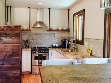 Paso Robles barn rental - Reclaimed barn wood dining table and kitchen shelves.