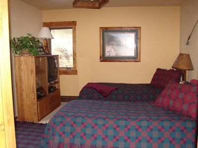 Extra long twin beds with TV and adjoining bath & shower.