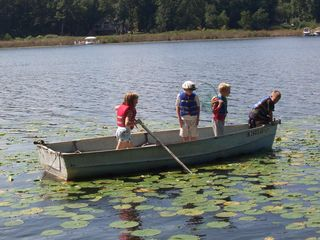 Angola cottage photo - Kids rowing the boat around the lake looking for frogs and turtles