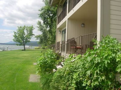 Condo #126 with deck furniture. Lake is 30 ft from stairs