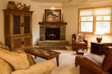 Enjoy Cozy Fireplace and Mountain Views from Living Room